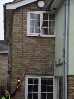 Me at work cleaning fascia using the Pure Water System